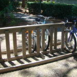 Standard Bike Rack, 6' Size, shown in Weathered Wood. Frame and spokes are solid recycled plastic - no metal to rust! Available in 6 colors and 3 sizes. 25 year warranty, USA made, stainless hardware.